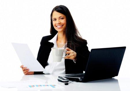 Happy businesswoman at work