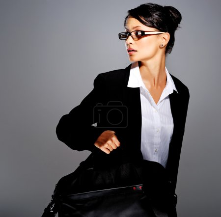 Businesswoman in suit with briefcase