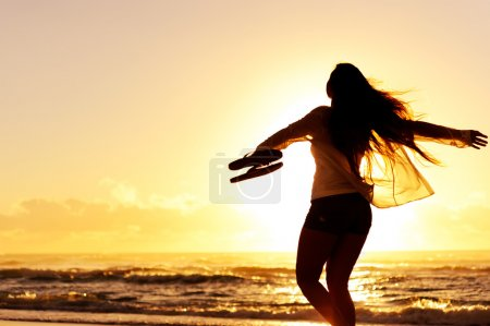 Silhouette woman beach