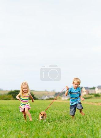 Cute siblings running in field