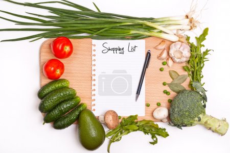 Photo for Notebook with shopping list in the cutting board - Royalty Free Image