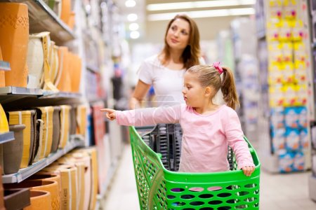 Photo for Mother and daughter in supermarket - Royalty Free Image