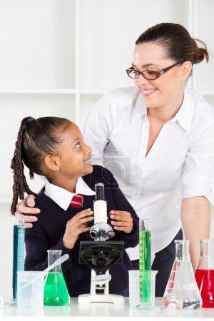 Friendly teacher talking to elementary student