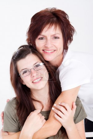 Happy teen daughter and mother