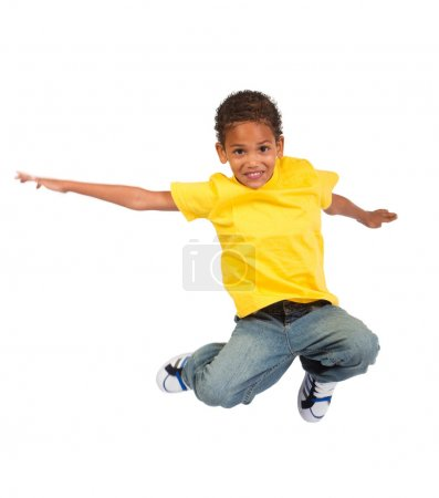 Photo for African american boy jumping over white background - Royalty Free Image