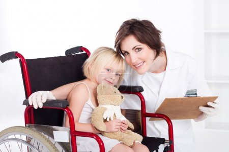 Caring nurse and smiling little girl patient