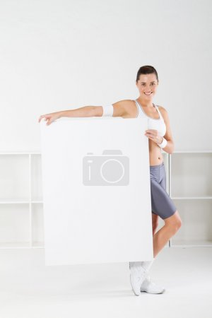 Fitness woman holding a white board