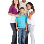 Happy multiracial family of four studio portrait...