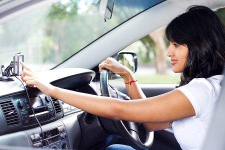 Female driver using GPS navigator