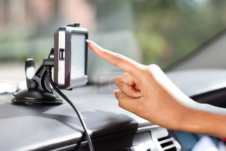 Photo for Finger pointing at car GPS navigation system - Royalty Free Image