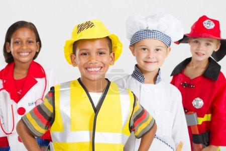 Foto de Grupo de pequeños trabajadores felices en varios uniformes - Imagen libre de derechos