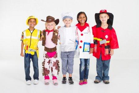 Foto de Grupo de niños vistiendo con varios uniformes - Imagen libre de derechos