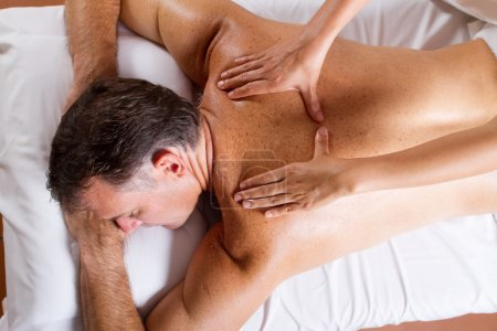 Middle aged man having back massage