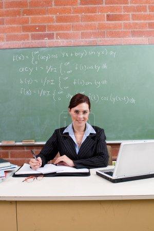 Female school teacher in classroom