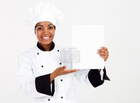 African american female chef presenting menu