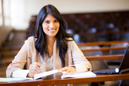 Photo for Beautiful female indian college girl in lecture hall - Royalty Free Image
