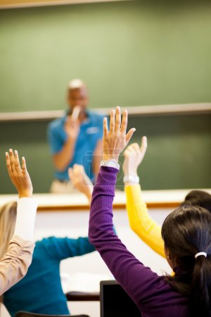 Photo for Group of students arms up in classroom - Royalty Free Image