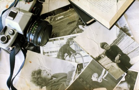 Old photographs and old camera. Youth of my mom.