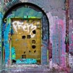 Urban door covered in graffiti...