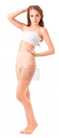 Young slim woman posing on white background