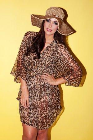 Beautiful brunette in straw hat