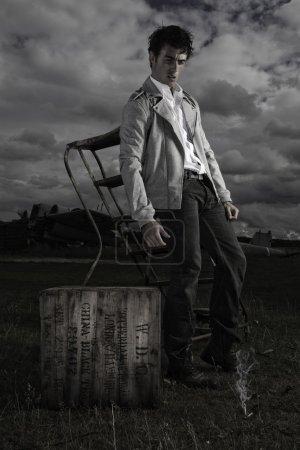 Dark moody image of young man