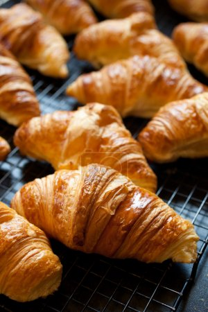 Photo for Delicious fresh croissants just out of the oven - Royalty Free Image