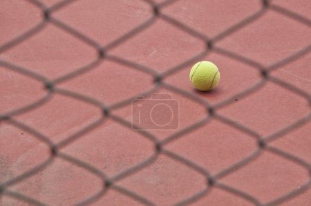 Tennis ball behind the net