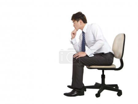 Businessman are thinking and sitting on the office chair