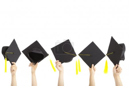 Many hand holding graduation hats and isolated on white