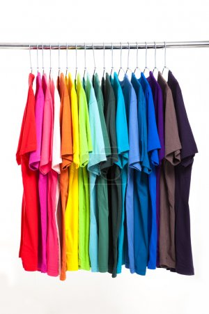 Photo for Colorful t-shirt with hangers isolated on white - Royalty Free Image