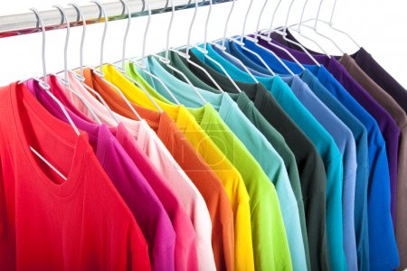 Variety of casual shirts on hangers...
