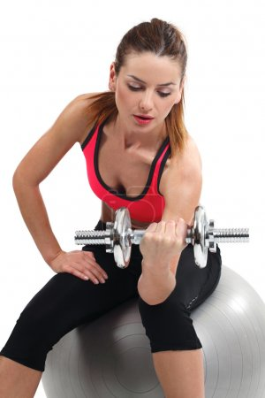 Female doing dumbbell curls