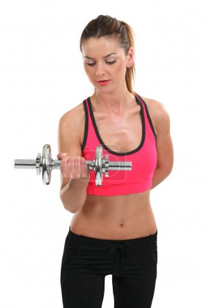 Young woman lifting a dumbbell