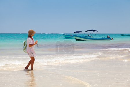 Girl having a walk in Palaya Paraiso, Mayan Riviera