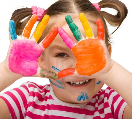 Photo for Portrait of a cute cheerful girl with painted hands, isolated over white - Royalty Free Image