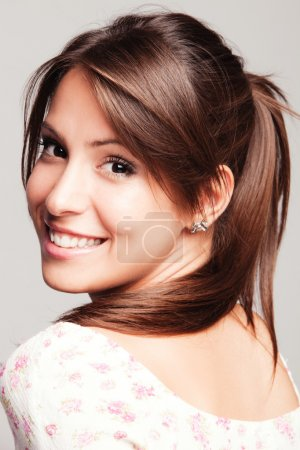 Photo for Friendly smiling young woman portrait studio shot - Royalty Free Image