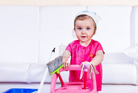 Photo for Sweet little girl doing housework - Royalty Free Image
