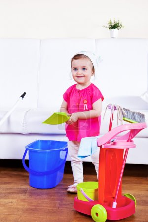 Photo for Smiling mom helper cleaning the room - Royalty Free Image