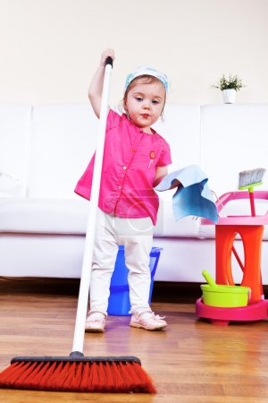 Photo for Lovely toddler girl cleaning the room - Royalty Free Image