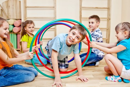 Photo for Children playing in school gym - Royalty Free Image