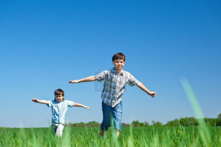 Photo for Kids playing in the meadow - Royalty Free Image