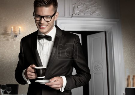Portrait of a elegant man with cup of coffee