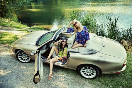Smiling women in a cabriolet...