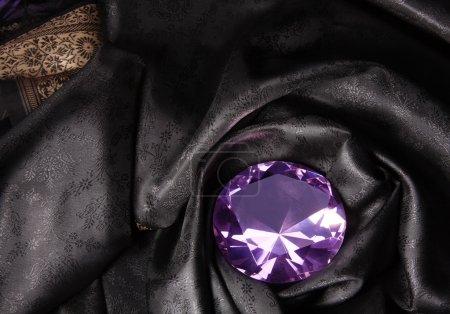 Pink diamond in the black fabric