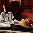 Romantic evening with bottle of champagne, sweets ...