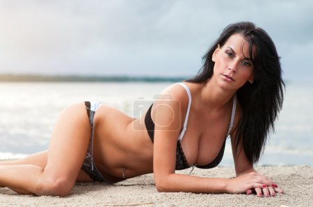 Beautiful young woman relaxing on the beach