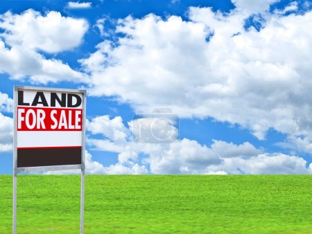 """Photo for Real estate conceptual image - """"FOR SALE"""" sign on empty meadow - Royalty Free Image"""