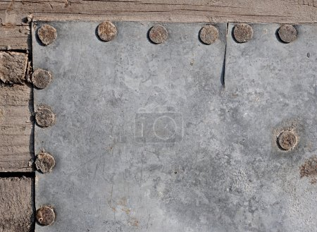 Photo for Empty aged metal plate on wooden background - Royalty Free Image