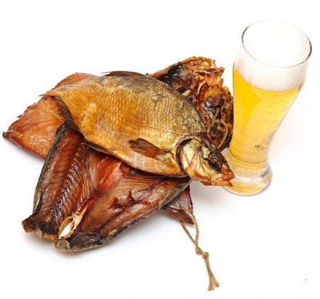 Pile smoked fish and cup of beer on a white background